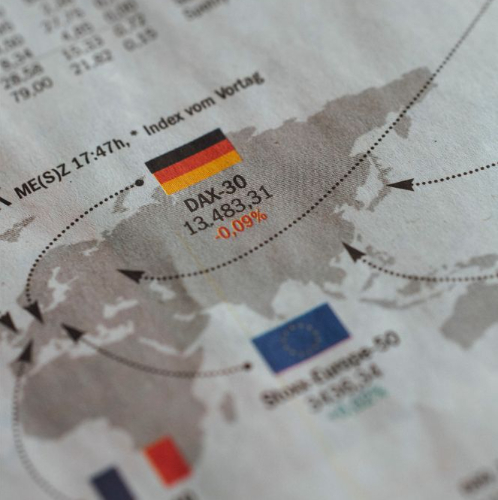 Global Business Growth - Flags of Germany EU and France in newspaper
